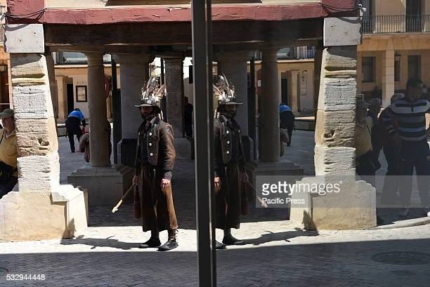 MAYOR ALMAZáN SORIA SPAIN A man pictured wearing a hat decorated with vulture feathers and a tail of fox representing an invincible shepherd that...