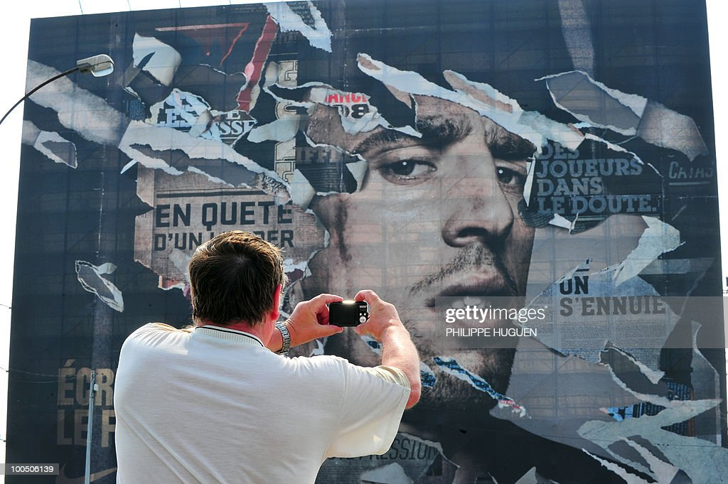 A man pictures a 800 m2 portrait of French football international Franck Ribery on May 25, 2010 in the northern city of Boulogne-sur-Mer, the place where the 27-year-old player of the Bayern's Munich was born. The project faced controversy when the Northern Pas-de-Calais region called to stop it after Ribery was questioned by French police on the under-age call-girl scandal which has rocked the France football team.