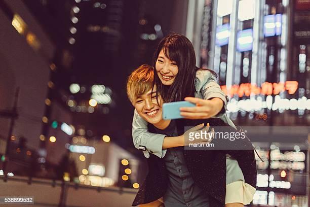 Man piggybacks girl for a selfie in Osaka