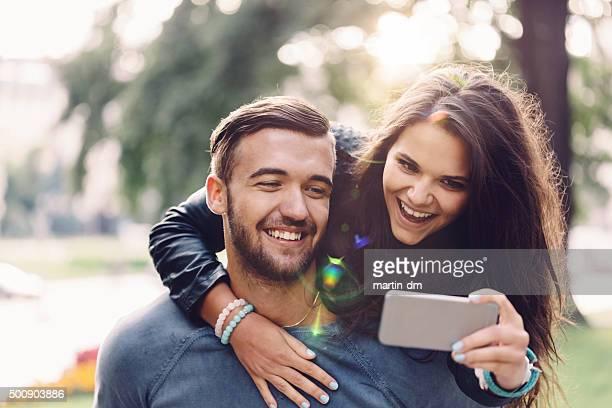 Man piggybacks girl for a selfie