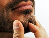 Man pinching chin
