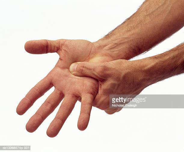 Man pinching hand, close-up