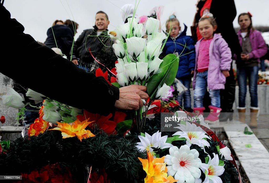 A man placed flowers on the grave of a relative during the 14th anniversary of the Recak massacre on January 15, 2013. In 1999, forty-five Albanian civilians were killed by Serb forces, in the village of Recak. The massacre, one of the bloodiest that occurred in the Kosovo crisis, led to massive international pressure on Serbia to stop their ethnically motivated killings of civilian Albanians and to a NATO led air campaign that ousted Serbian security forces from Kosovo.