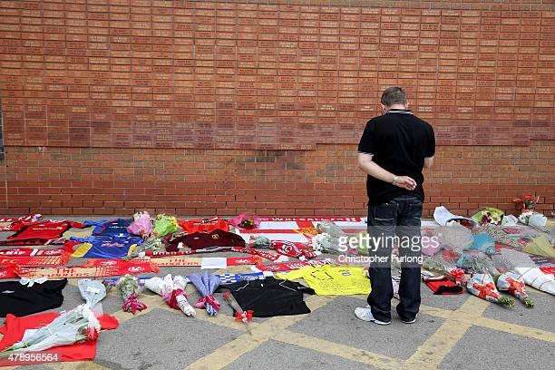 A man places a tribute outside Walsall Football Club in memory of Adrian Evans Patrick Evans and Joel Richards who were among 38 people who killed in...