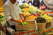 A man places bruised fruit in a bin at a market on January 10 2013 in New York City A new Londonbased study by the The Institution of Mechanical...