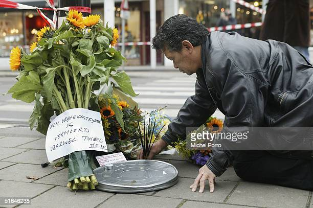 A man places flowers near the crime scene where Dutch film maker Theo van Gogh was killed November 2 2004 in Amsterdam Netherlands Van Gogh was well...