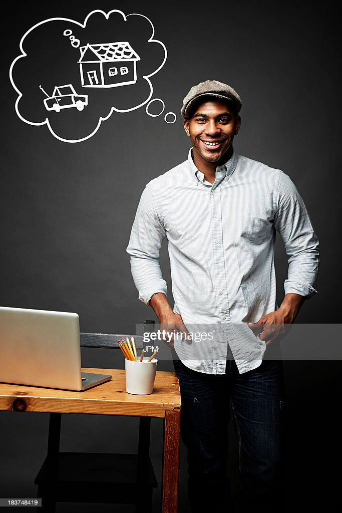Man planning for new house and car : Stock Photo