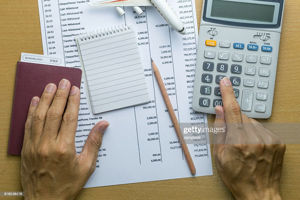 Man planning monthly budget, Finance about Travel concept : Stock-Foto