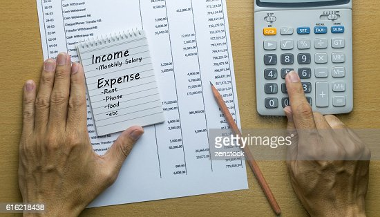 Man Planning monthly income and account expenses : Photo
