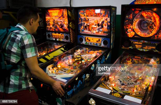 Man play on flipper machine on Pixel Heaven fair in Warsaw 26 May Poland
