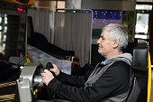 Man playing arcade game machine at an amusement park
