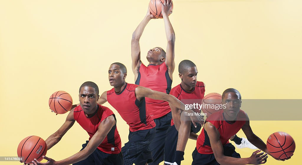 man playing basketball cloned several times : Stock Photo