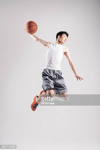Man playing basketball on White Background