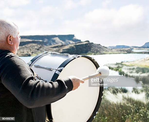 Man Playing Bass Drum Overlooking River