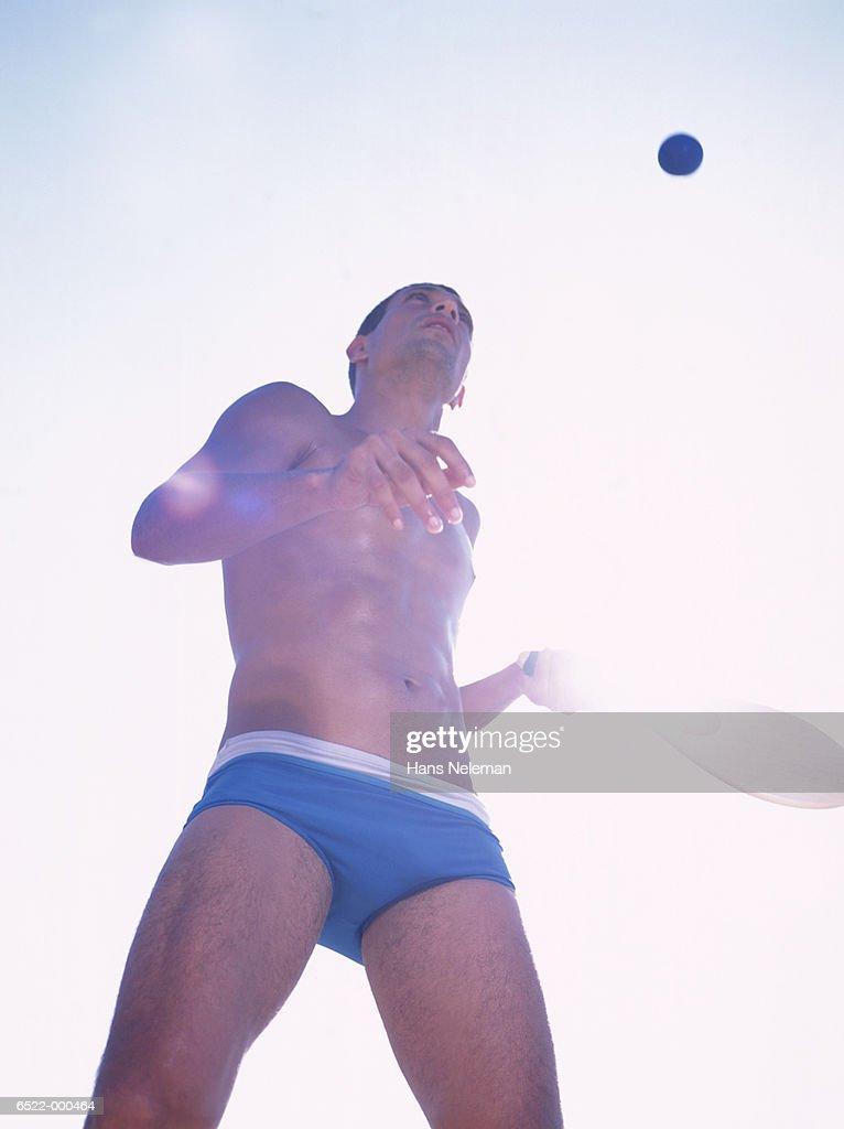 Man Playing Beach Tennis : Stock Photo