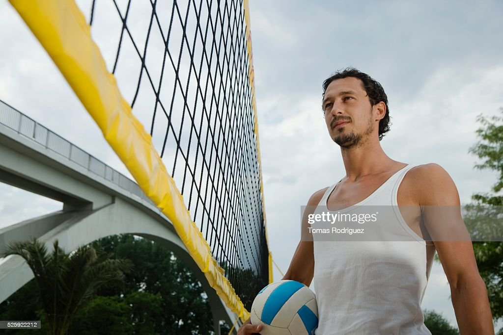 Man Playing Beach Volleyball : Stock Photo