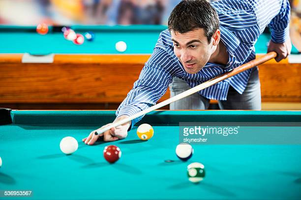 Man playing billiard.