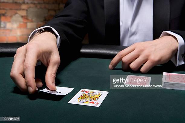 Man playing blackjack in casino