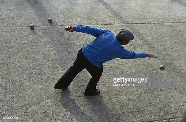 Man Playing Bocce Ball