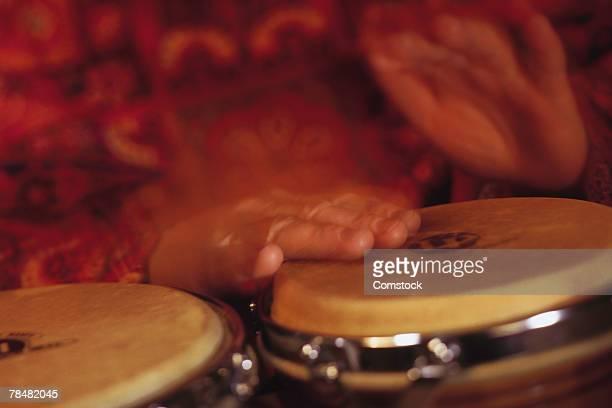 Man playing bongo drums