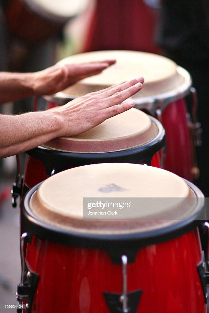 Man playing bongos : Stock Photo
