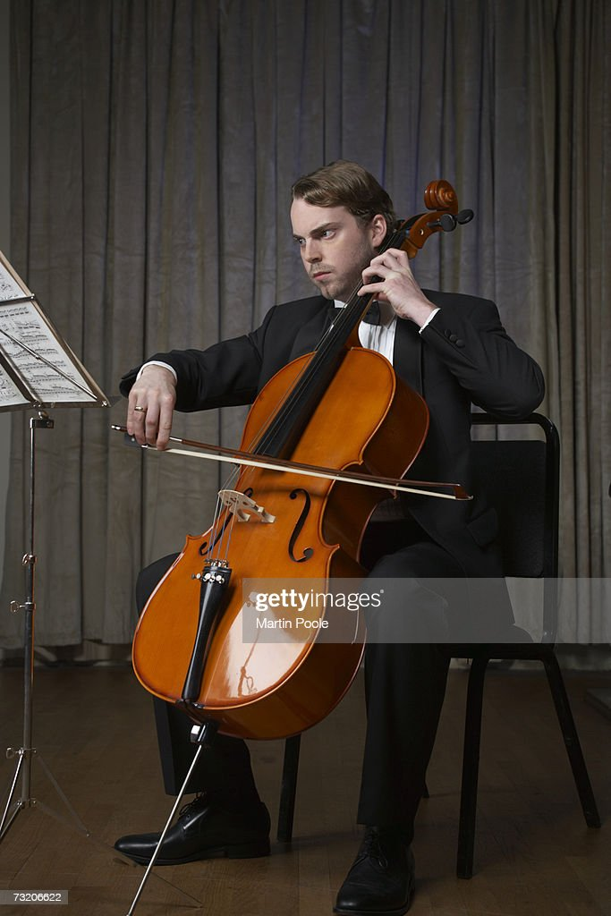 Man playing cello, full length : Stock Photo