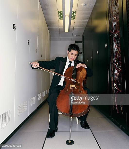 Man playing cello in server room