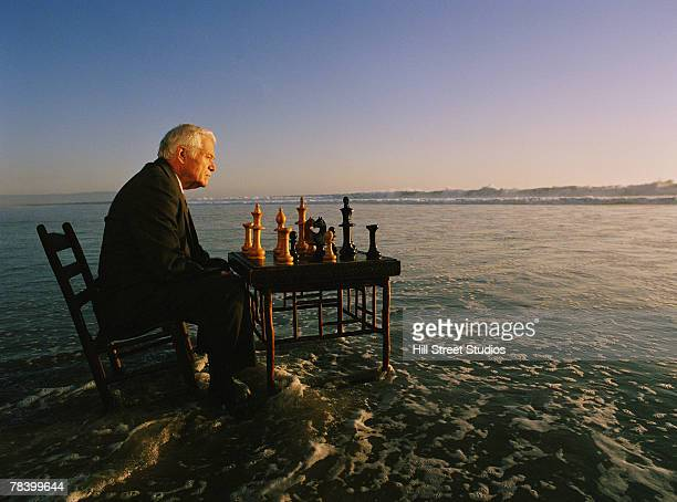 Man playing chess on the beach