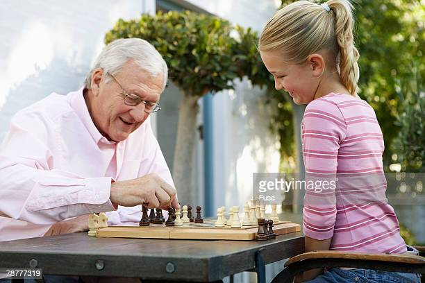 Man Playing Chess with Granddaughter