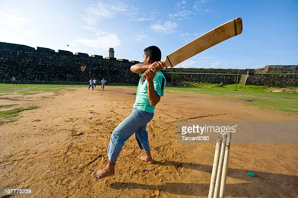 Man playing cricket