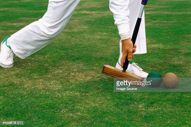 Man playing croquet