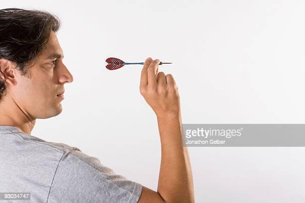 Man playing darts