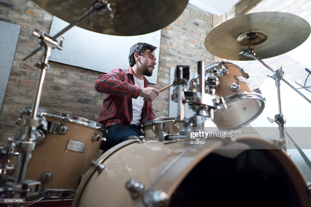 Man playing drums at a recording studio : Stock Photo