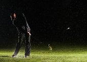 Man playing golf, hitting ball