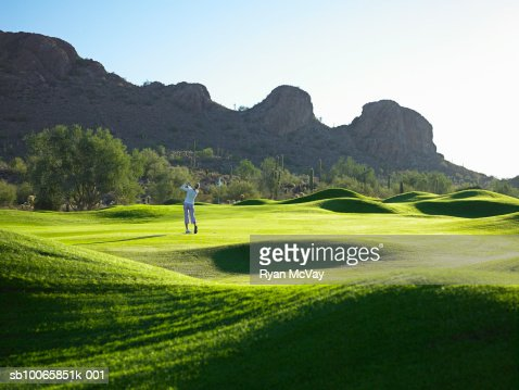 Man playing golf on course
