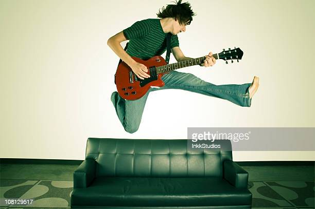 Man Playing Guitar and Jumping