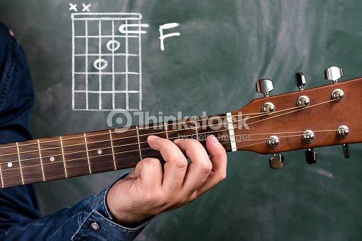 Man Playing Guitar Chords Displayed On A Blackboard Chord F Stock ...