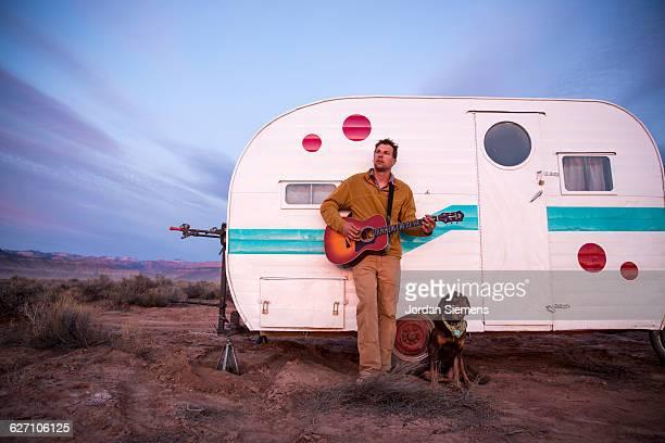 A man playing guitar.