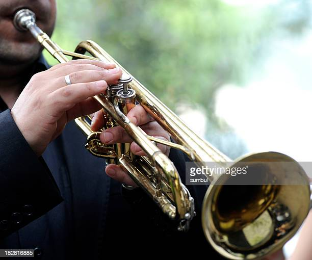 Man playing his trumpet outside
