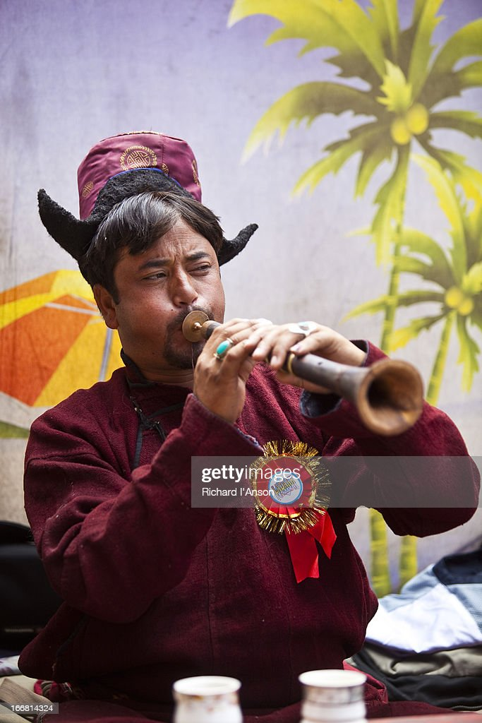 Man playing horn during Ladakh Festival : Stock Photo