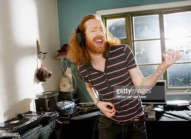 Man playing imaginary guitar.