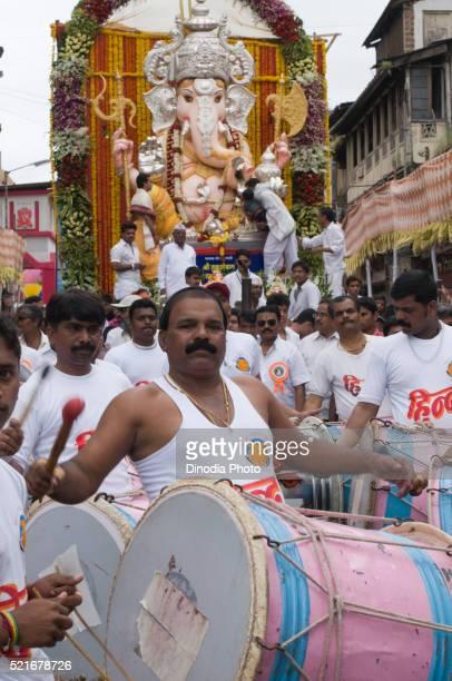 Man playing musical instrument, Pune, Maharashtra, India, Asia