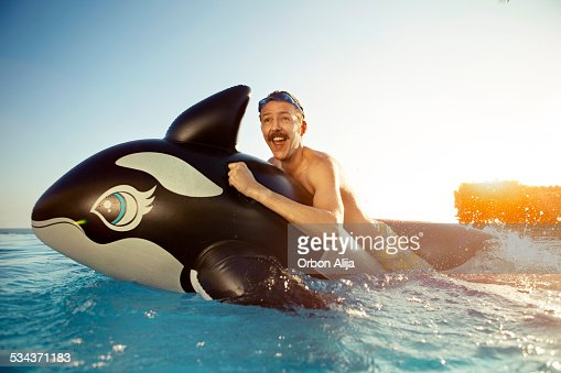 Man playing on a inflated whale