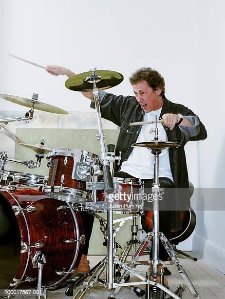 Man playing on drum kit