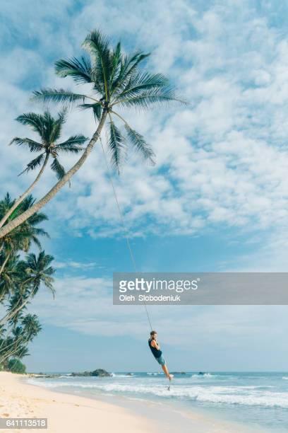 Man playing on rope swing