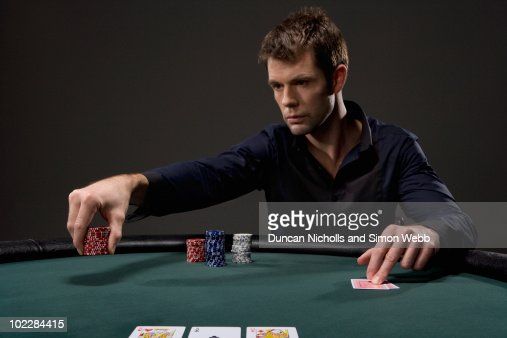 Man playing poker in casino