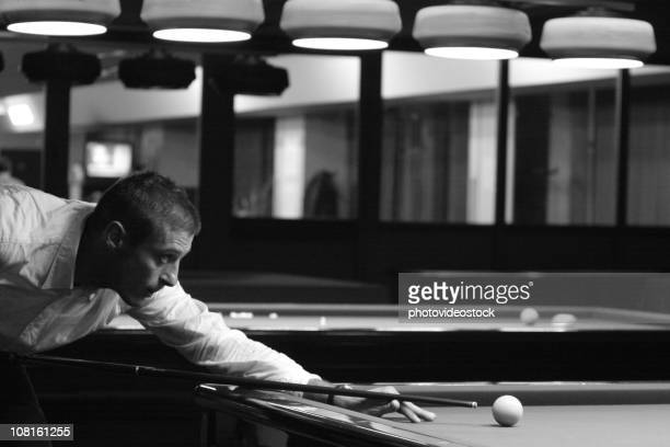 Man Playing Pool in Hall, Black and White