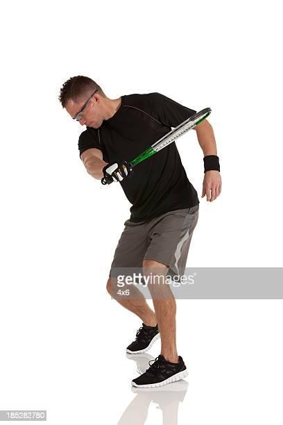 Homem Jogando racquetball