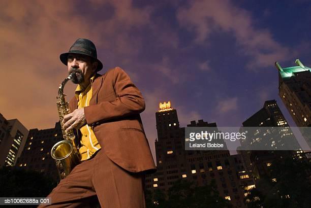 Man playing saxophone, low angel view