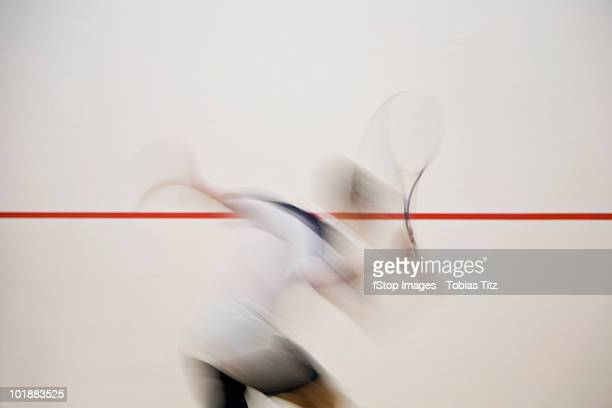 A man playing squash, blurred motion,  Melbourne, Victoria, Australia